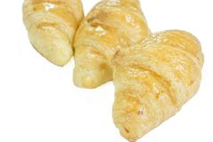 Single Butter Croissant isolated on white - clipping path included Stock Photos