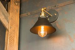Old-fashion lamp hanging on wooden wall Stock Photos