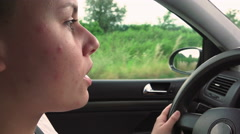 Happy Girl in a car driving and singing Stock Footage