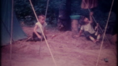 3446 a family campsite in a forest campground-vintage film home movie Stock Footage