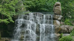Waterfall. Streams of water among large boulders Stock Footage