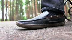 Black patent leather men's shoes stomping or fills rhythm on open air Stock Footage