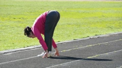 4k, young beautiful sportswoman doing leg stretching on the stadium 1 - stock footage