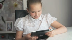 Little girl holding a digital tablet computer Stock Footage