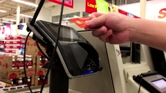 Close up of man tapping Tangerine credit card for paying foods Stock Footage
