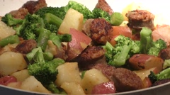 Skillet with Italian sausages and vegetables Stock Footage