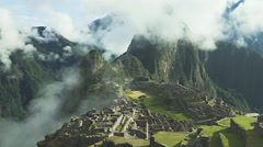 Mist rising from a valley at machu picchu Stock Footage
