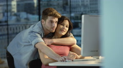 4K Young couple chatting & using computer together in New York City apartment - stock footage