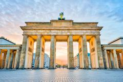 Brandenburg Gate with the sunrise in Berlin, Germany - stock photo