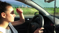 Gorgeous car driver drive blind against strong sun shine Stock Footage