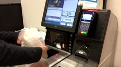 Close up of woman paying foods at self-check out counter - stock footage