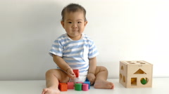 Little child playing with wood blocks Stock Footage