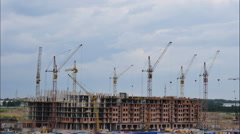 The construction of the house, working construction cranes ,  timelapse Stock Footage