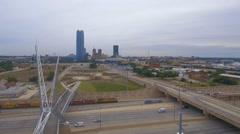 Aerial shot SkyDance Pedestrian Bridge Oklahoma City as Train Passes Stock Footage