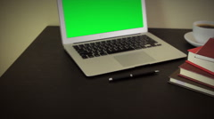 PC computer with coffee cub and notebook on table Stock Footage