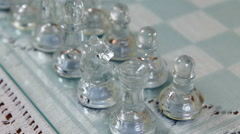 Camera Moving Along Line Of Glass Chess Players On Board Looking Down Stock Footage