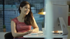 4K Young woman making a video call on computer in city apartment. Stock Footage