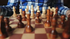 Pretty girl knocks figure in the game of chess - stock footage