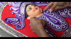 Artist preparing Goddess Durga clay idol, Kolkata, Calcutta, India - stock footage