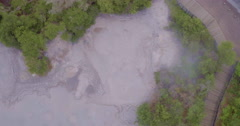 Aerial of hot mudpools in Rotorua Stock Footage