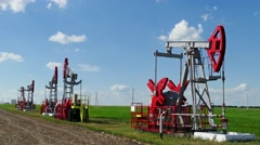 Working oil pumps in a row at sunny day, 4k Stock Footage