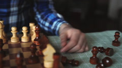 Pretty girl knocks figure in the game of chess Stock Footage