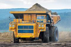 June, 2016 - Buryatia, Russia: Trucks working in open pit. Stock Photos