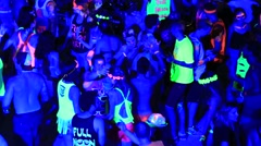 Girls and guys dancing the beach during full moon party, Koh Phangan, Thailand - stock footage