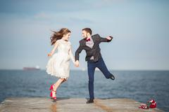 Happy just married young wedding couple celebrating and have fun at beautiful Stock Photos