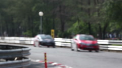 Racing cars enter into closeup turn in curve. - stock footage