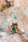 Top View of cute female Climber and Belayer looking up - stock photo