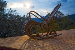 Vintage wooden Rocking Chair at lumber Cottage Terrace Stock Photos
