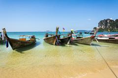 Longtail boats in Railay beach, Krabi peninsula in Thailand - stock photo