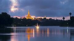 Shwedagon Pagoda Yangon Myanmar Day To Night Timelapse With Lake Reflection Stock Footage