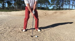 Golfer hits bunker shot Stock Footage