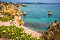 Natural rocks and beaches at Lagos Portugal Stock Photos
