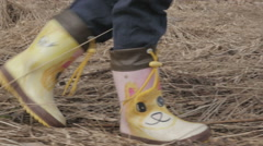 Child in boots walking through the woods in the spring, fps96 Stock Footage