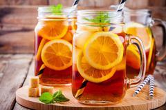 Ice tea with slice of lemon in mason jar Stock Photos