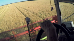Farmer driving combine harvester for harvesting wheat Stock Footage