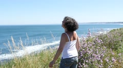 A middle-aged woman contemplates the ocean Stock Footage
