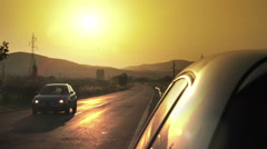 Angle shot of a car and traffic against sunset in the background Stock Footage