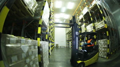 Loader in the warehouse transports the goods. Stock Footage