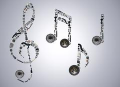 Treble clef assembled from new auto spare parts - stock photo