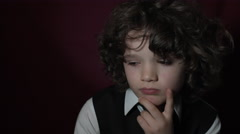 4k Shot of a Cute Businessman Child Thinking and Dreaming Stock Footage