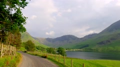Driving through a small road in the Lake District at sunset, England Stock Footage