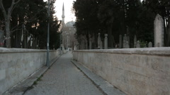 Graveyard and the narrow streets of the city Stock Footage