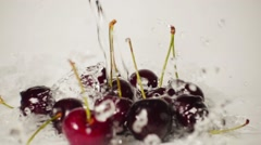 Cherry and water splash, slow motion - stock footage