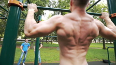 The man is engaged on the bar, the back muscles Stock Footage