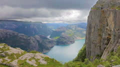 Tourists hiking at the Preikestolen cliff in lysefjorden Norway Stock Footage