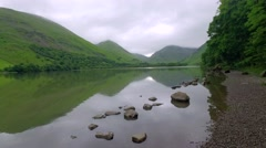 Lake and mountains on a cloudy day in the Lake District, England Stock Footage